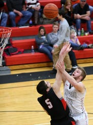 Rosecrans senior Michael Fisher puts pressure on Coshocton