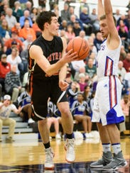 Central York's Evan Czulada (32) keeps a ball in bounds