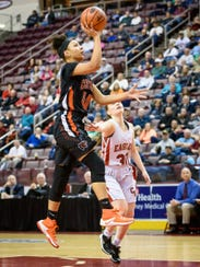 Central York's Teirra Preston (40) drives for a layup