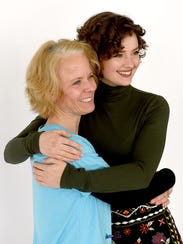 Jennifer Sitler, left, poses for a photograph with
