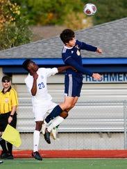 Kazuma Bals of Hartland heads the soccer ball in front