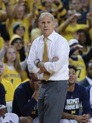 Michigan head coach John Beilein on the bench against