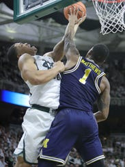 Miles Bridges is defended by Michigan's Charles Matthews in the second half. Bridges had 19 points, six rebounds, five assists and four turnovers.