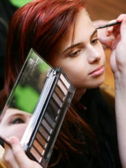 Makayla Sheets, 11, gets her makeup done by Julianna