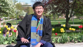 Xiong Her, who was born in a Hmong refugee camp in Thailand, is graduating from Marquette University on Sunday.