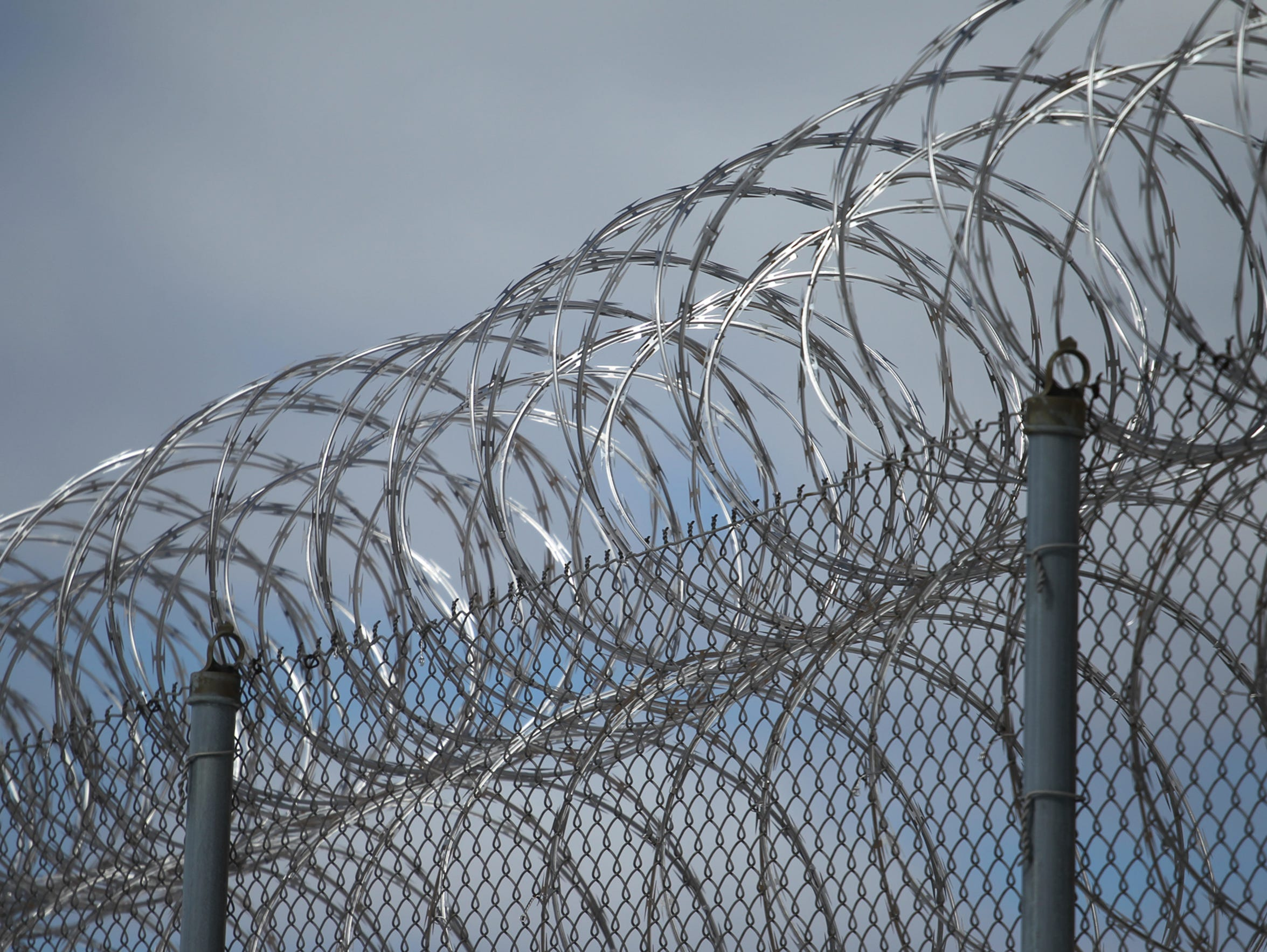 Razor wire tops one of the fences at the Lincoln Hills