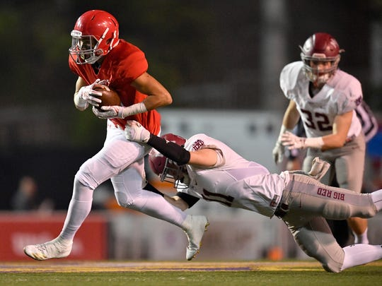 Brentwood Academy's Camron Johnson (27) slips past MBA's Gordon Pollock (11) during the first half of the Division II-AAA state championship game at Tucker Stadium in Cookeville, Tenn., Saturday, Dec. 2, 2017.
