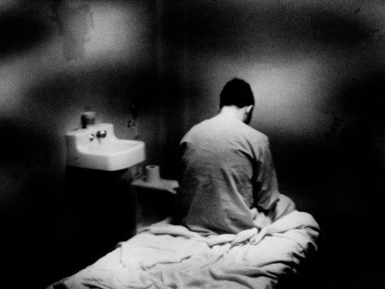 "David Berkowitz, the accused ""Son of Sam"" killer, sits on a bunk in his isolation cell at Kings County Hospital, 1977."