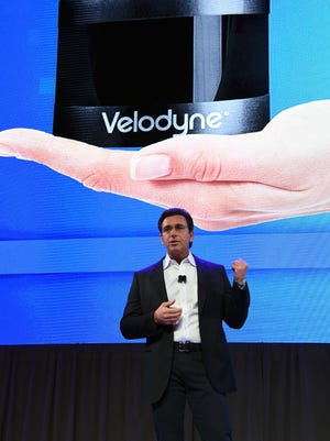 Mark Fields, Ford president and CEO, speaks in front of an image of the Velodyne Solid State Hybrid Ultra Puck Auto LiDAR Sensor that is being used in Ford's autonomous-vehicle plans during a press event for CES 2016 on January 5, 2016 in Las Vegas.