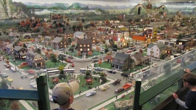 Two boys wait for a model train to pass through the miniature town of Fairfield at Roadside America in Shartlesville.