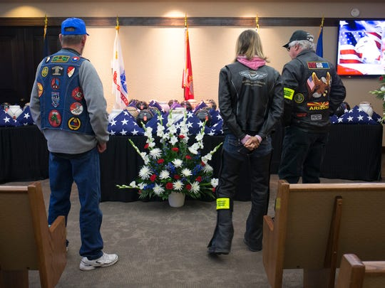 Patriot Guard Riders view the cremated, unclaimed remains