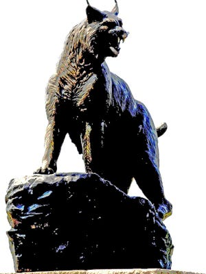 A bronze wildcat, the Pinelands Regional School District's mascot, sits at the entrance to the Pinelands Regional High School.