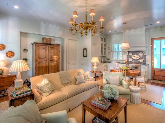Sheffield Construction Company's team of skilled craftsmen brought design details to life, including butted-wood ceiling, reclaimed-pine floors and antique brick fireplace. Brandon Ingram of Atlanta designed the cottage with Sheffield