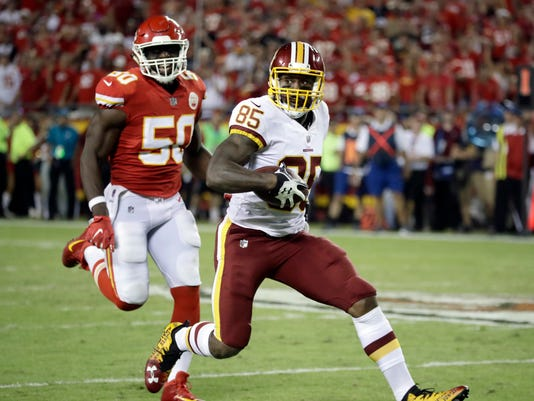"""FILE - In this Monday, Oct. 2, 2017 file photo, Washington Redskins tight end Vernon Davis (85) is chased by Kansas City Chiefs linebacker Justin Houston (50) during the second half of an NFL football game in Kansas City, Mo. Jay Gruden will have what Vernon Davis is having. Marveling at the physical condition of the 33-year-old tight end, the Washington Redskins coach asked Davis what he had for lunch and came away saying, """"We should all get on the Vernon Davis diet."""" Davis is careful about what he eats, trains his body and his mind and is on pace for one of his better seasons in his 12th year in the NFL. (AP Photo/Charlie Riedel, File)"""