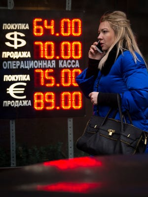 Signs advertising the ruble's exchange rate light next to the exchange office in Moscow on Dec. 16, 2014.