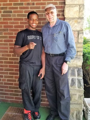 MJ (left) is a teenager who is spreading his wings with guidance and help from his foster parent, George Jackson (right).