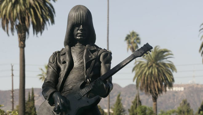 A statue of Johnny Ramone, founder of the band The Ramones, stands at the Garden of Legends in the Hollywood Forever cemetery in Los Angeles.