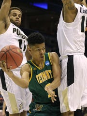 Vermont guard Trae Bell-Haynes (2) is sanwhcihed between Purdue guard P.J. Thompson (11) and forward Vince Edwards (12) during their first round game of the NCAA Division I Men's Basketball tournament game Thursday, March 16, 2017 at the BMO Harris Bradley Center in Milwaukee.