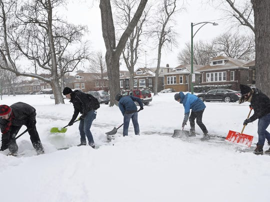 Volunteers shovel sidewalks on South Wabash Avenue in the Chatham neighborhood Saturday, Jan. 19, 2019, in Chicago. Organized by My Block, My Hood, My City, more than 50 people gathered to clear snow from sidewalks and front steps throughout the South Side.