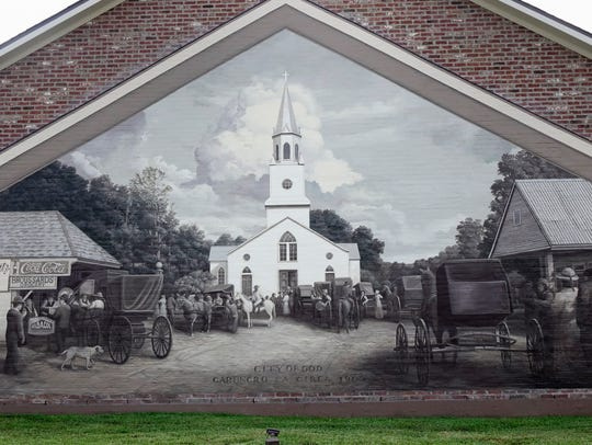 A Robert Dafford mural depicting Carencro  circa 1900