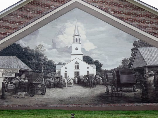 A Robert Dafford mural depicting Carencro  circa 1900 on the front of building Friday, August 11, 2017.