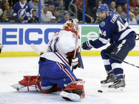 Montreal Canadiens goalie Carey Price (31) stops Tampa Bay Lightning center Nate Thompson (44) on a breakaway in overtime of Game 1 of a first-round NHL hockey playoff series on Wednesday, April 16, 2014, in Tampa, Fla. The Canadiens won the game 5-4. (AP Photo/Chris O'Meara)