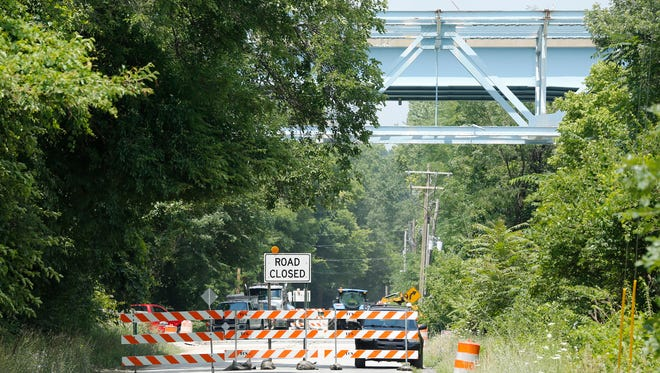 Reconstruction work on the Sagamore Parkway bridge over the Wabash River as seen from North River Road Monday, July 11, 2016, in West Lafayette.