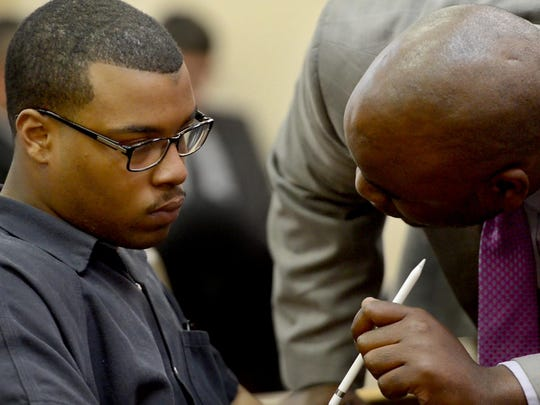 Attorney Jamaal Boykin confers with his client, Trimon Pruitt on Thursday afternoon during Pruitt's preliminary hearing. Pruitt is charged with first-degree murder in the death of Tony Willoughby.