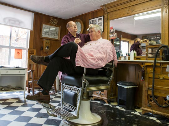 "Middletown barbershop owner Charles ""Chopper Charlie"" Biggs cuts the hair of Neal Sentman of Chesapeake City, Maryland, in his shop on Main Street in Middletown last week. ""Lower, Slower Delaware, it's called, but we're not going to be Slower Delaware any more,"" Biggs said."