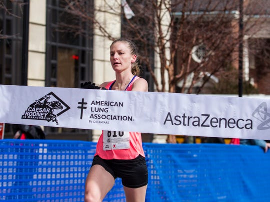 CR HALF MARATHON: Elizabeth Swierzbinski races to the finish line first among all female racers, and 18th overall, in the Caesar Rodney Half-Marathon in Wilmington on Sunday morning.