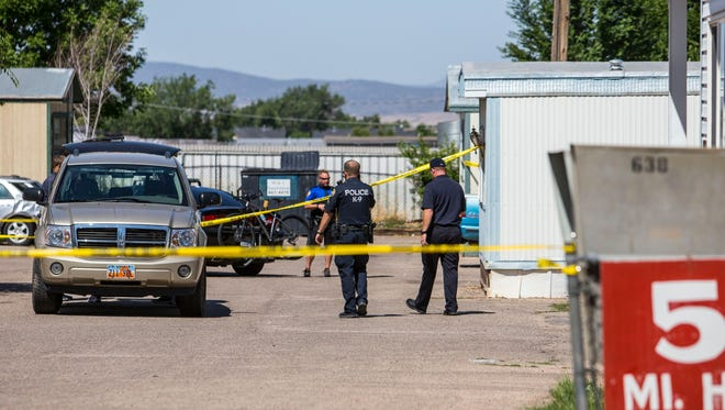Police tape blocks of the entrance to Reber Court trailer park in Cedar City after a fatal shooting, Sunday, July 24, 2016.
