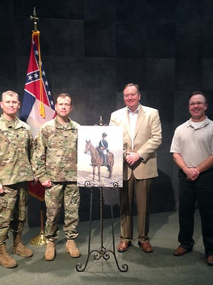 On Friday, the Mississippi Armed Forces Museum added a series of art by Mark Poole. Pictured, from left, are Lt. Col. Michael Honeycutt, deputy commander of Camp Shelby; Col. Gregory Michel, commander of Camp Shelby;  Chad Daniels, director of the Mississippi Armed Forces Museum; and Poole, fine arts instructor at Mississippi Gulf Coast Community College.