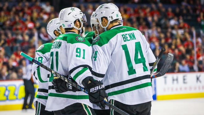 Stars forward Jamie Benn (14) celebrates his goal with teammates.