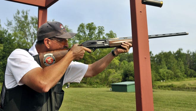 Retired St. Cloud Fire Dept. Capt. Joe Opitz fires on a clay target in 2012 during the five-stand sporting clays event of the Can-Am Police-Fire Games at Del-Tone/Luth Gun Club in St. Cloud.