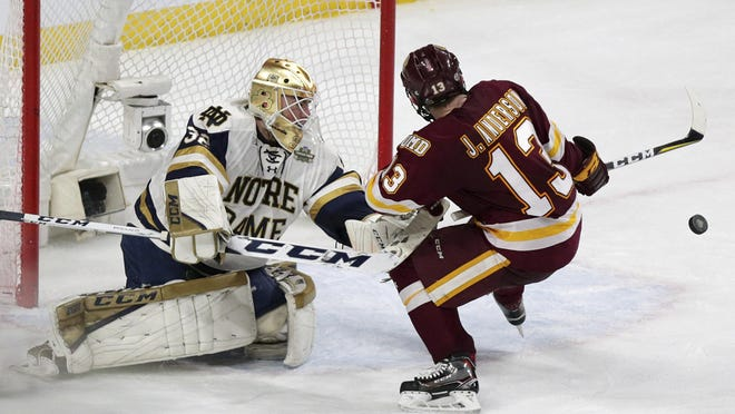 Former Notre Dame goalie Cale Morris (32) stops Minnesota Duluth right wing Joey Anderson (13) during the NCAA men's Frozen Four championship on April 7, 2018 in St. Paul, Minn. Morris is now a member of the Rockford IceHogs.