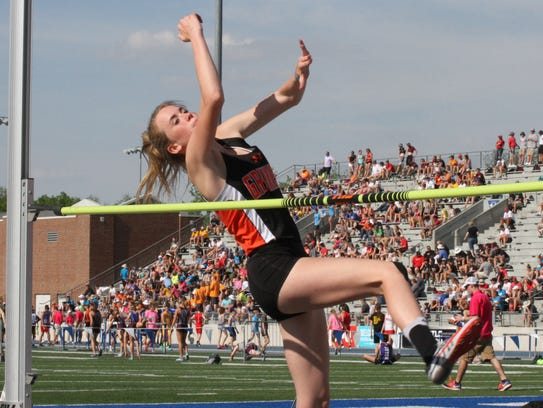 Grinnell's Kylee Neighbors clears the bar on her way