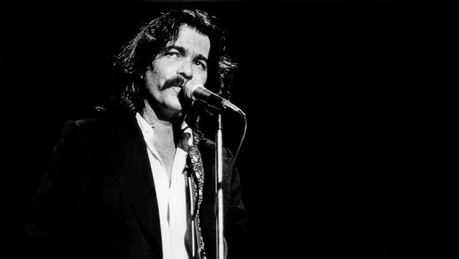 Singer and songwriter John Prine, sporting a longer hairstyle and a new rockabilly addition to his repertoire, is performing for his fans during his Tennessee Theater concert Nov. 26, 1979.