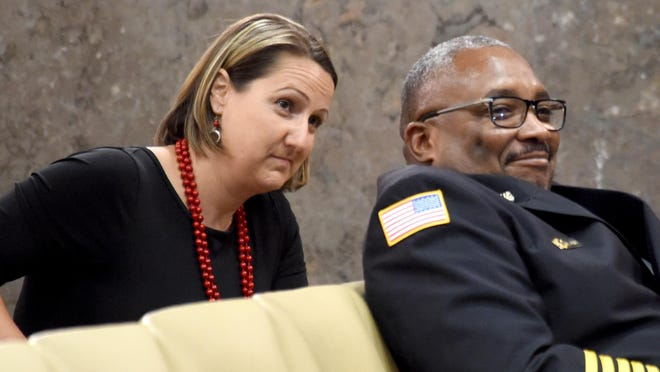 Jody Smitherman, the Augusta Fire Department's legal counsel, sits with Fire Chief Chris James. James said he wasn't aware of involvement by Smitherman's husband at the time of the bids for painting a fire station.
