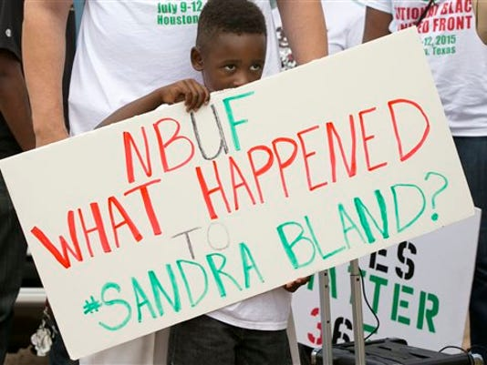 William Mitchell, 5, of Houston, holds a sign at a rally at the Waller County Jail in Hempstead, Texas on Friday to protest the death of Sandra Bland, who was found dead in the jail.