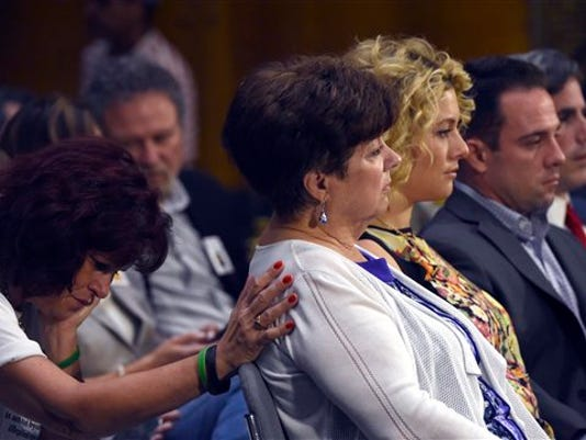 Liz Sullivan, mother of Kathryn Steinle, is consoled by Sabine Durden, left, while listening to testimony during a Senate Judiciary hearing to examine the Administration's immigration enforcement policies, in Washington, Tuesday, July 21, 2015.