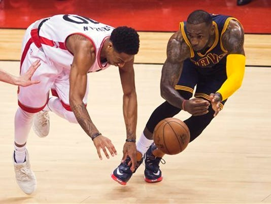 FILE - In this May 27, 2016, file photo, Cleveland Cavaliers forward LeBron James, right, steals the ball from Toronto Raptors guard DeMar DeRozan (10) during the first half of Game 6 of the NBA basketball Eastern Conference finals in Toronto. Toronto and Cleveland are meeting again in the NBA playoffs. On the way to winning their first title last season, James and the Cavs took care of the Raptors in the Eastern Conference finals, a series that was tied 2-2 before Cleveland won the final two games. (Nathan Denette/The Canadian Press via AP, File)