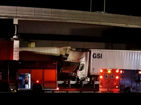 The scene of a multi-vehicle accident that closed the New Jersey Turnpike Monday near Cranbury. A highway pileup involving 15 or more vehicles including box trucks, tractor-trailers and a bus on Monday night left at least one person dead and several others injured.