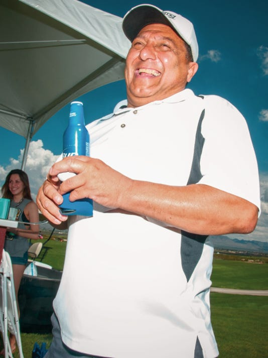 "Jett Loe--Sun-News   Mike Avelar of Peter Piper Pizza enjoys himself at the Burger Time ""Sandra B. McGrath"" Golf Tournament at Red Hawk Golf Club on Thursday."