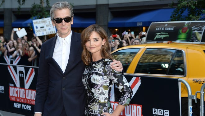 """Actors Peter Capaldi and Jenna Coleman - who play the Doctor and Clara on """"Doctor Who"""" - attend BBC America's premiere screening at the Ziegfeld Theatre in New York City in August 2014. """"Doctor Who,"""" a staple of British television, has become more popular than ever in the U.S."""