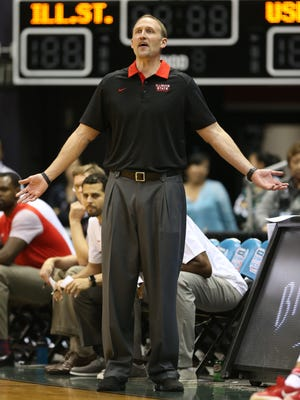 Illinois State coach Dan Muller extends his arms and expresses disbelief after a non-call by the officials.