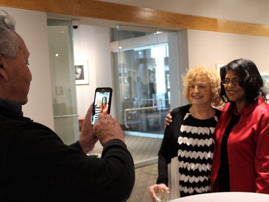 Mike McLinn, left, takes a photo of his wife, Dr. Claudette