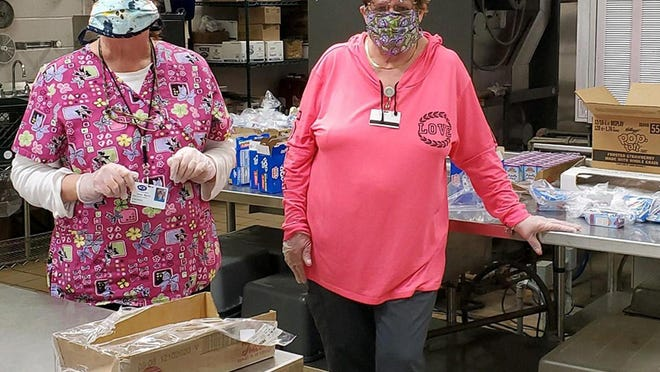 Terri Barry and Karen Smith, food service workers at Sullivan County BOCES, were among those who helped plan delivery and preparation of meals for students in the area.