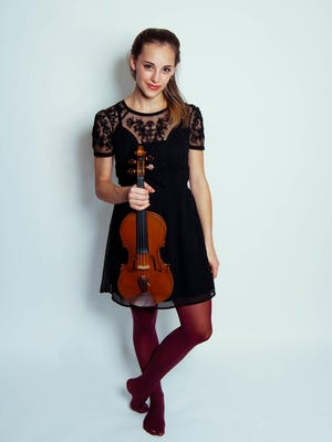Violinist Chelsea Starbuck Smith performs with the Orchestra of the Southern Finger Lakes on Saturday.
