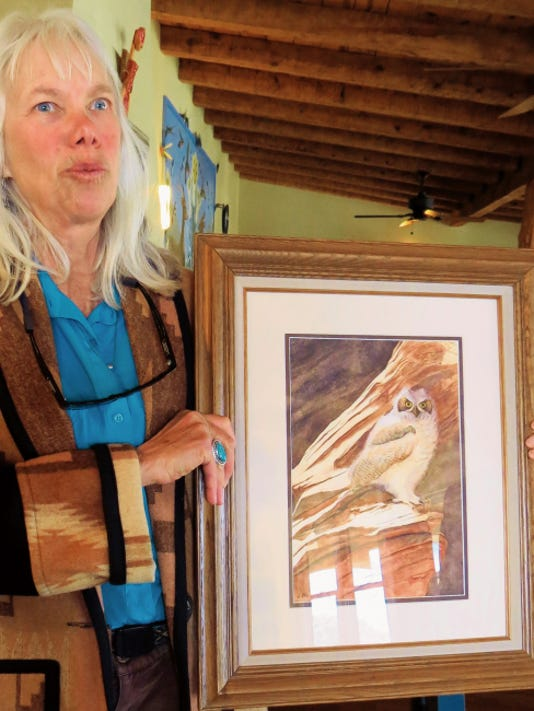 """Courtesy Photo   Artist Jackie Blurton is shown with her watercolor painting, """"Great Horned Owlet,"""" that won third place in the Fine Arts Watercolor Division of the Grant County Art Guild's Members Opening Art Show."""