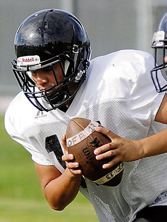 Robin Zielinski/Sun-News   Onate quarterback Tony Herrera is a first-year starter and part of a solid junior class at OHS after 25 seniors graduated from last year's playoff team.
